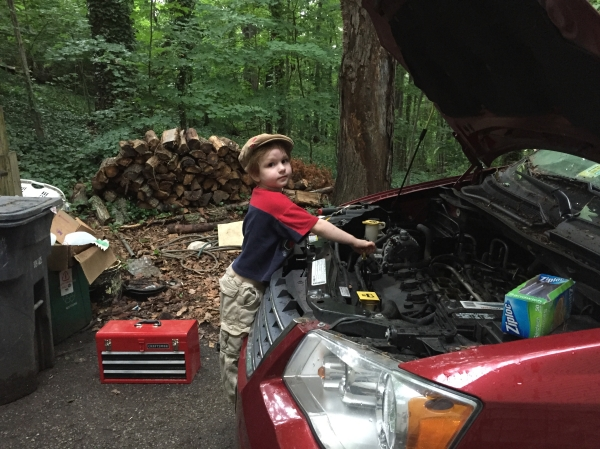 Guy Works On the Car With Dad